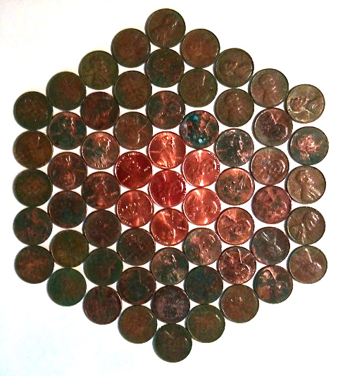 Pennies aged in vinegar solution