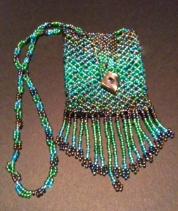 The beaded bag I made was used for the photograph.  It reminds me of lizard skin.